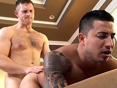 Bending forward, he invites his friend fro fuck his ass bareback style