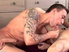 Two young guys are impassioned cocksuckers