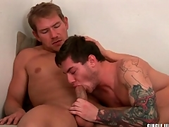 Guy down sleeve tattoo sucks a big cock