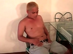 Cute Asian blonde plays with his concise dick