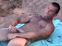 Pierced nipple gay guy jerks off on make an issue of beach