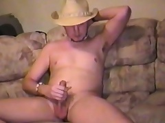 Sexy young stud plays with his balls and takes his cock to pleasure