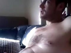 Dishy supplicant is having fun at home and filming himself on computer webcam