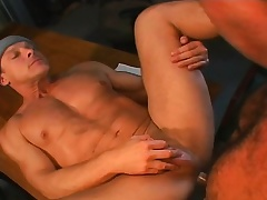 Muscled gay mechanics engage in a hardcore threesome in the garage