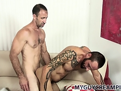Tattooed hunk gets a touch someone for full of cum from his hung sex-friend