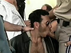 Huge group of uniformed dudes get on their knees more suck cock