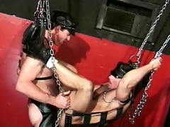 Careless leather pain in the neck fuck in a sex swing