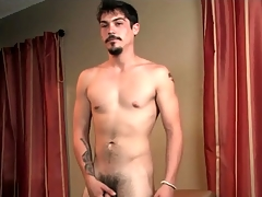 Merely brunette with goatee masturbates cock