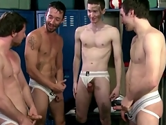 Soccer players drag inflate and stroke in jockstraps