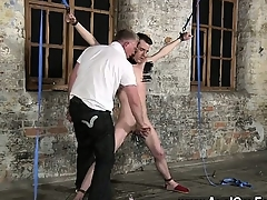 Nude men Sean McKenzie is trussed up and at the mercy of mas