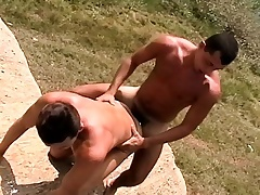 Muscled young cadger bends over to divulge a vicious rod of pleasure