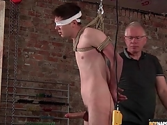 Daddy jerks off bound boy in BDSM integument