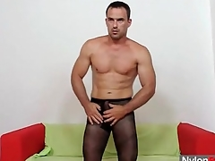 Robust man in pantyhose fucks a toy