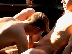 Guys in a market bed suck toes and balls
