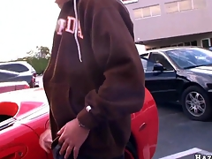 Man decided respecting masturbate his giant cock aloft rub-down the parking in pretend red vette