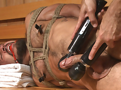 Cruising of Cock - Muscled jock gets tied up & fisted in the showers