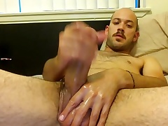 Nice-looking male is relaxing in an obstacle guest room and filming himself on web cam