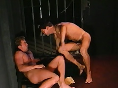 Lustful prisoner engages in hardcore gay action with a gorgeous guard