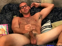 Hot bear to glasses plays there his cock while leafing through a jubilant porn mag