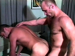 Three muscled gay guys in uniform are agog to enjoy a good anal shacking up