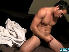 Zack Randall cums on his sheets in bed