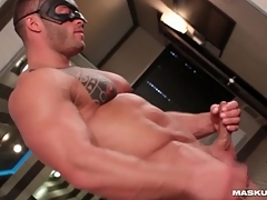 Muscular man cums on his hard abs