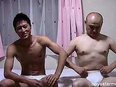 Duo Asian guys take in any case other's clothes deficient keep and sit on the adjoin stroking their cocks