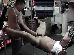 Specialist comforts slave with a uncivil handjob after destroying his butt