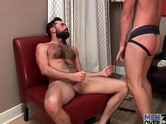 Hottie in jockstrap sucks bear cock