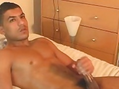Nadim get wanked his huge arab cock by a guy.