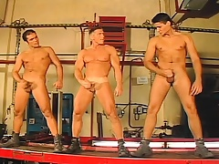 Three handsome gay mechanics enjoy anal sex together with able-bodied unload together